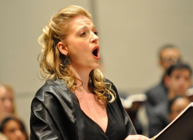 Dr. Betsy Uschkrat sings with a symphony.