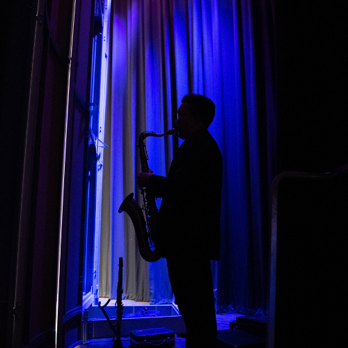 Saxophone player silhouetted