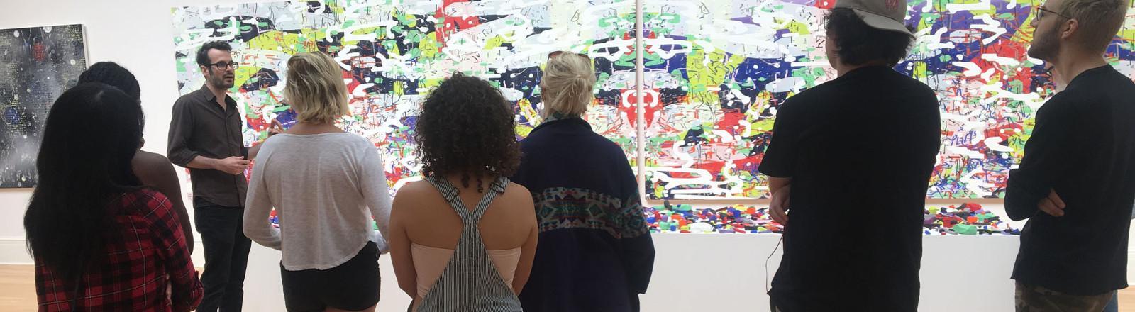 Loyola art students listen to a gallery talk.