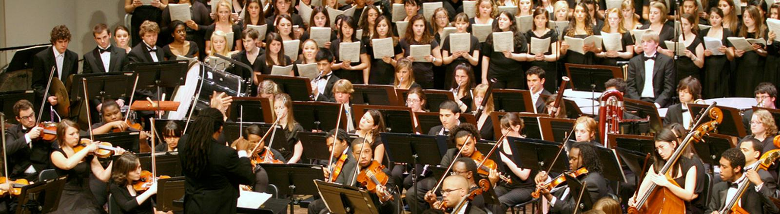 Dr. Jean Montes directs the Loyola Symphony Orchestra in Roussel Hall.