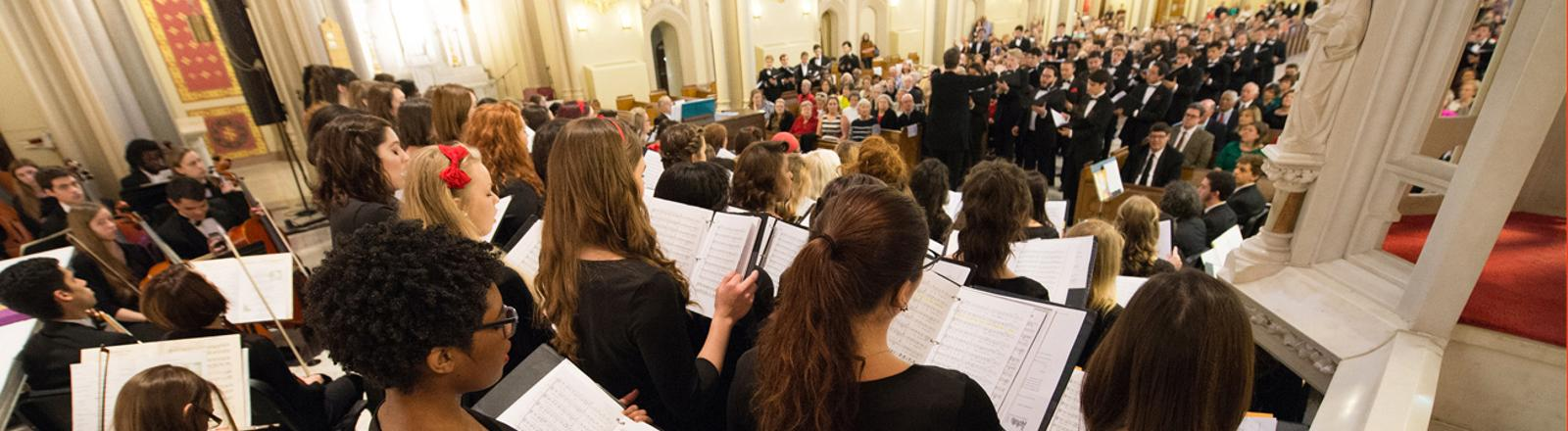 The Loyola Chamber Orchestra and Choirs perform in Holy Name of Jesus Church.