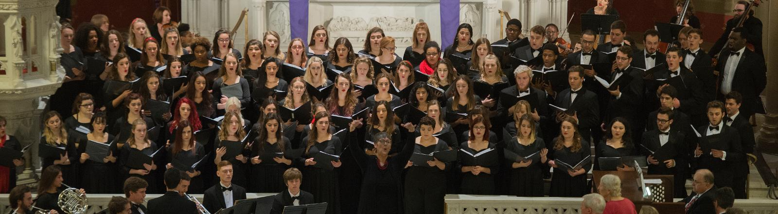 Dr. Meg Frazier conducts the Loyola Chorale in Holy Name of Jesus Church.