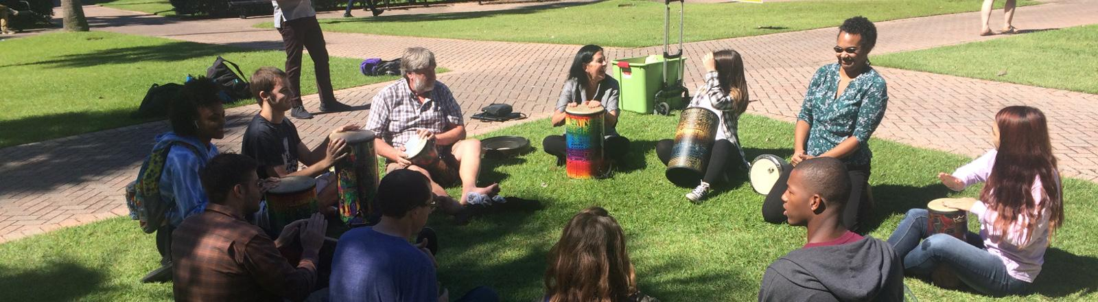 Loyola Music Therapy students play in a drum circle in Palm Court.