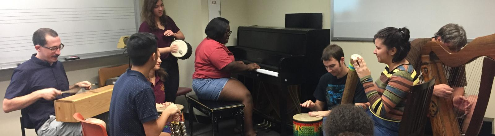 Loyola School of Music Music Therapy Majors practice percussion during improvisation class.