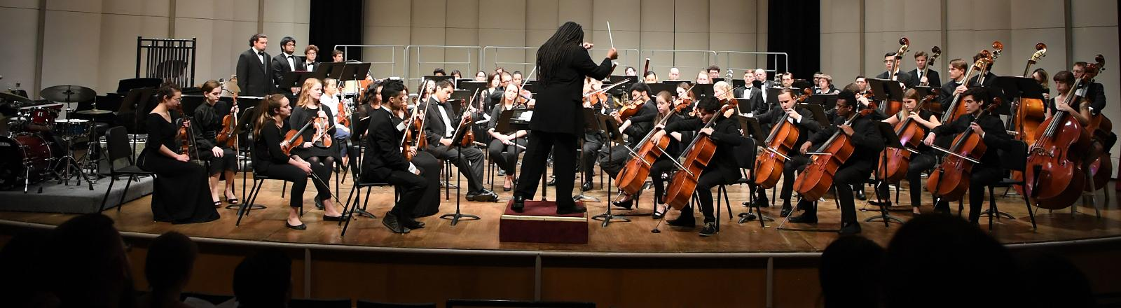 Dr. Montes directing the orchestra in concert