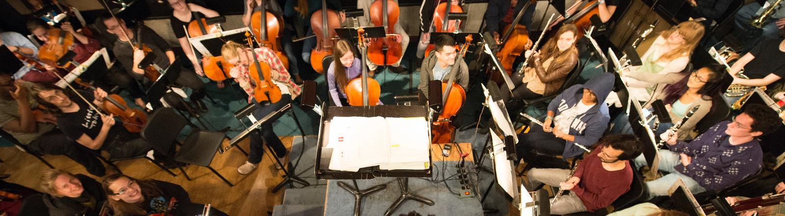 The Loyola School of Music Symphony Orchestra rehearses in the pit of Roussel Hall.