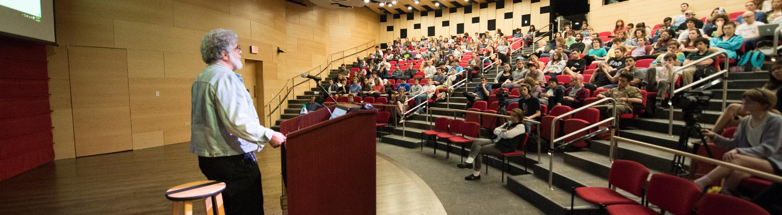 Loyola professor giving a lecture to students in Nunemaker hall