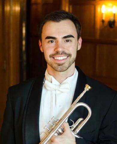 Alex Mayon, holding trumpet