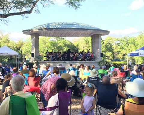 Loyola orchestra performing at Music Under the Oaks