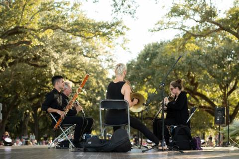 Loyola Faculty performing at Music Under the Oaks