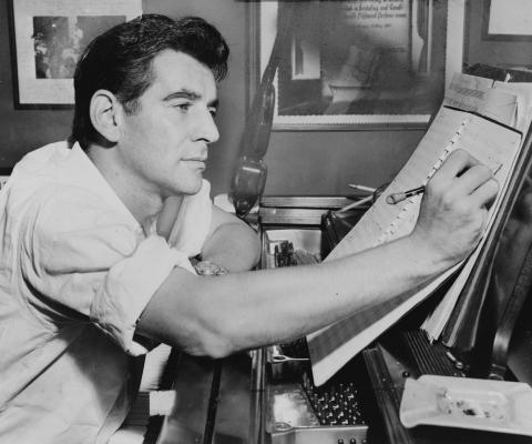 Leonard Bernstein pictured writing music.