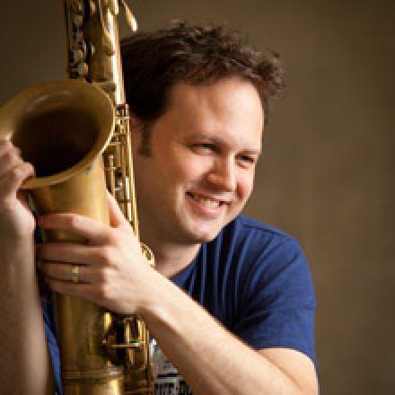 Jason Mingledorf pictured with saxophone.